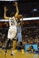 Dec 28, 2013; Memphis, TN, USA; Memphis Grizzlies small forward Tayshaun Prince (21) guards Denver Nuggets point guard Ty Lawson (3) during the second quarter at FedExForum. Mandatory Credit: Justin Ford-USA TODAY Sports