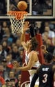 Dec 28, 2013; Portland, OR, USA; Portland Trail Blazers center Robin Lopez (42) puts in a shot past Miami Heat shooting guard Dwyane Wade (3) during the first quarter of the game at the Moda Center. Mandatory Credit: Steve Dykes-USA TODAY Sports