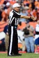 Oct 27, 2013; Denver, CO, USA; NFL referee Ron Winter (14) starts a down in the fourth quarter between the Washington Redskins against the Denver Broncos at Sports Authority Field at Mile High. Mandatory Credit: Ron Chenoy-USA TODAY Sports
