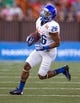 Dec 24, 2013; Honolulu, HI, USA; Boise State Broncos running back Devan Demas (26) runs during the 2013 Hawaii Bowl against Oregon State Beavers at Aloha Stadium. Mandatory Credit: Marco Garcia-USA TODAY Sports