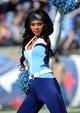 Dec 29, 2013; Nashville, TN, USA; A Tennessee Titans cheerleader performs before a game against the Houston Texans at LP Field. The Titans beat the Texans 16-10. Mandatory Credit: Don McPeak-USA TODAY Sports