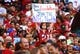 Dec 29, 2013; Phoenix, AZ, USA; An Arizona Cardinals fan holds a sign in the grandstands against the San Francisco 49ers at University of Phoenix Stadium. The 49ers defeated the Cardinals 23-20. Mandatory Credit: Mark J. Rebilas-USA TODAY Sports