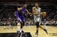 Dec 29, 2013; San Antonio, TX, USA; San Antonio Spurs forward Tim Duncan (21) drives to the basket while guarded by Sacramento Kings forward Jason Thompson (left) during the first half at the AT&T Center. Mandatory Credit: Soobum Im-USA TODAY Sports