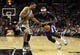 Dec 29, 2013; San Antonio, TX, USA; Sacramento Kings guard Ben McLemore (right) drives against San Antonio Spurs forward Tim Duncan (21) during the second half at the AT&T Center. The Spurs won 112-104. Mandatory Credit: Soobum Im-USA TODAY Sports