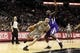 Dec 29, 2013; San Antonio, TX, USA; San Antonio Spurs guard Manu Ginobili (20) drives to the basket while guarded by Sacramento Kings forward Quincy Acy (5) during the first half at the AT&T Center. Mandatory Credit: Soobum Im-USA TODAY Sports