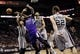Dec 29, 2013; San Antonio, TX, USA; Sacramento Kings center DeMarcus Cousins (15) gets fouled while shooting against San Antonio Spurs forward Tiago Splitter (22) during the second half at the AT&T Center. The Spurs won 112-104. Mandatory Credit: Soobum Im-USA TODAY Sports