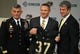 Dec 30, 2013; West Point , NY, USA; Army Black Knights head football coach Jeff Monken poses for the media alongside West Point Superintendent Lieutenant general Bob Caslen and athletic director Boo Corrigan at Randall Hall in the Kimsey Athletic Center in his first press conference since being named the new head coach at West Point. Mandatory Credit: Danny Wild-USA TODAY Sports