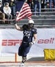 Dec 30, 2013; Fort Worth, TX, USA; Navy Midshipmen guard Eric Mahler (74) waves an American flag on the field before the game against the Middle Tennessee Blue Raiders at Amon G. Carter Stadium.  Navy beat Middle Tennessee 24-6. Mandatory Credit: Tim Heitman-USA TODAY Sports