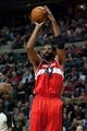 Dec 30, 2013; Auburn Hills, MI, USA; Washington Wizards power forward Nene Hilario (42) shoots during the fourth quarter against the Detroit Pistons at The Palace of Auburn Hills. Washington won 106-99. Mandatory Credit: Tim Fuller-USA TODAY Sports