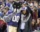 Dec 27, 2013; San Francisco, CA, USA; Washington Huskies mascot Harry (left) poses with fan Kymber Payne at the 2013 Fight Hunger Bowl at AT&T Park. Mandatory Credit: Kirby Lee-USA TODAY Sports