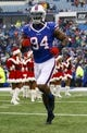 Dec 22, 2013; Orchard Park, NY, USA; Buffalo Bills defensive end Mario Williams (94) runs on the field before a game against the Miami Dolphins at Ralph Wilson Stadium. Mandatory Credit: Timothy T. Ludwig-USA TODAY Sports