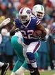 Dec 22, 2013; Orchard Park, NY, USA; Buffalo Bills running back Fred Jackson (22) runs the ball against the Miami Dolphins at Ralph Wilson Stadium. Mandatory Credit: Timothy T. Ludwig-USA TODAY Sports