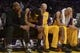 Dec 31, 2013; Los Angeles, CA, USA; Los Angeles Lakers players (from left) Kobe Bryant and Jordan Hill and Chris Kaman and Robert Sacre react in the fourth quarter against the Milwaukee Bucks at Staples Center. The Bucks defeated the Lakers 94-79. Mandatory Credit: Kirby Lee-USA TODAY Sports