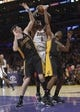 Dec 31, 2013; Los Angeles, CA, USA; Milwaukee Bucks center Larry Sanders (8) is defended by Los Angeles Lakers forawrd Ryan Kelly (4) and guard Nick Young (0) during the game at Staples Center. Mandatory Credit: Kirby Lee-USA TODAY Sports