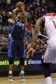 Jan 1, 2014; Washington, DC, USA;  Dallas Mavericks shooting guard Monta Ellis (11) shoots the ball in front of Washington Wizards center Kevin Seraphin (13) in the third quarter at Verizon Center. The Mavericks won 87-78. Mandatory Credit: Geoff Burke-USA TODAY Sports