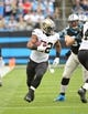 Dec 22, 2013; Charlotte, NC, USA; New Orleans Saints running back Mark Ingram (22) runs as Carolina Panthers outside linebacker Chase Blackburn (93) defends in the second quarter at Bank of America Stadium. Mandatory Credit: Bob Donnan-USA TODAY Sports