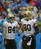 Dec 22, 2013; Charlotte, NC, USA; New Orleans Saints tight end Jimmy Graham (80) reacts with wide receiver Kenny Stills (84) after scoring a touchdown in the fourth quarter. The Panthers defeated the Saint 17-13 at Bank of America Stadium. Mandatory Credit: Bob Donnan-USA TODAY Sports