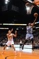Jan 2, 2014; Phoenix, AZ, USA; Memphis Grizzlies guard Mike Conley (11) lays up the ball against the Phoenix Suns guard Gerald Green (14) in the first half at US Airways Center. Mandatory Credit: Jennifer Stewart-USA TODAY Sports