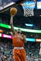 Jan 2, 2014; Salt Lake City, UT, USA; Milwaukee Bucks point guard Brandon Knight (11) shoots during the first half against the Utah Jazz at EnergySolutions Arena. Mandatory Credit: Russ Isabella-USA TODAY Sports