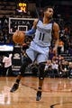 Jan 2, 2014; Phoenix, AZ, USA; Memphis Grizzlies guard Mike Conley (11) handles the ball against the Phoenix Suns in the first half at US Airways Center.  The Grizzlies won 99-91. Mandatory Credit: Jennifer Stewart-USA TODAY Sports