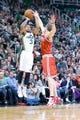 Jan 2, 2014; Salt Lake City, UT, USA; Utah Jazz point guard Trey Burke (3) shoots against Milwaukee Bucks point guard Luke Ridnour (13) during the second half at EnergySolutions Arena. The Jazz won 96-87. Mandatory Credit: Russ Isabella-USA TODAY Sports