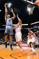 Jan 2, 2014; Phoenix, AZ, USA; Memphis Grizzlies center Kosta Koufos (41) puts up the ball against the Phoenix Suns forward Miles Plumlee (22) in the first half at US Airways Center.  The Grizzlies won 99-91. Mandatory Credit: Jennifer Stewart-USA TODAY Sports