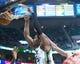 Jan 2, 2014; Salt Lake City, UT, USA; Utah Jazz power forward Derrick Favors (15) dunks during the second half against the Milwaukee Bucks at EnergySolutions Arena. The Jazz won 96-87. Mandatory Credit: Russ Isabella-USA TODAY Sports