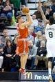 Jan 2, 2014; Salt Lake City, UT, USA; Milwaukee Bucks point guard Luke Ridnour (13) shoots against Utah Jazz point guard Diante Garrett (8) during the second half at EnergySolutions Arena. The Jazz won 96-87. Mandatory Credit: Russ Isabella-USA TODAY Sports