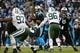 Dec 15, 2013; Charlotte, NC, USA; Carolina Panthers quarterback Cam Newton (1) looks to pass as New York Jets outside linebacker Calvin Pace (97) and defensive end Muhammad Wilkerson (96) pressure in the second quarter at Bank of America Stadium. Mandatory Credit: Bob Donnan-USA TODAY Sports