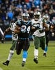 Dec 15, 2013; Charlotte, NC, USA; Carolina Panthers running back DeAngelo Williams (34) scores a touchdown as New York Jets defensive back Aaron Berry (22) and inside linebacker David Harris (52) defend in the second quarter at Bank of America Stadium. Mandatory Credit: Bob Donnan-USA TODAY Sports