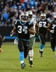 Dec 15, 2013; Charlotte, NC, USA; Carolina Panthers running back DeAngelo Williams (34) scores a touchdown as New York Jets inside linebacker David Harris (52) defends in the second quarter at Bank of America Stadium. Mandatory Credit: Bob Donnan-USA TODAY Sports