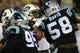 Dec 15, 2013; Charlotte, NC, USA; New York Jets quarterback Geno Smith (7) looks to pass as Carolina Panthers defensive end Charles Johnson (95) and outside linebacker Thomas Davis (58) pressure in the fourth quarter at Bank of America Stadium. Mandatory Credit: Bob Donnan-USA TODAY Sports