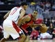 Jan 3, 2014; Washington, DC, USA; Toronto Raptors point guard Kyle Lowry (7) dribbles as Washington Wizards shooting guard Garrett Temple (17) defends during the second half at Verizon Center. The Raptors defeated the Wizards 101 - 88. Mandatory Credit: Brad Mills-USA TODAY Sports