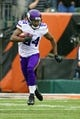Dec 22, 2013; Cincinnati, OH, USA; Minnesota Vikings wide receiver Cordarrelle Patterson (84) runs the ball in the game against the Cincinnati Bengals at Paul Brown Stadium. Cincinnati Bengals beat the Minnesota Vikings by the score of 42-14. Mandatory Credit: Trevor Ruszkowksi-USA TODAY Sports