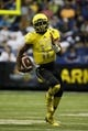 Jan 4, 2014; San Antonio, TX, USA; West quarterback Jerrod Heard (12) runs with the ball during U.S. Army All-American Bowl high school football game at the Alamodome. Mandatory Credit: Soobum Im-USA TODAY Sports