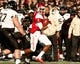 Jan 4, 2014; Birmingham, AL, USA; Houston Cougars quarterback Greg Ward Jr. (1) carries the ball against the Vanderbilt Commodores during the 2014 Compass Bowl at Legion Field. The Commodores defeated the Cougars 41-24. Mandatory Credit: Marvin Gentry-USA TODAY Sports