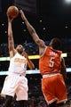 Jan 4, 2014; Phoenix, AZ, USA; Phoenix Suns forward Markieff Morris (11) puts up the ball over Milwaukee Bucks forward Ekpe Udoh (5) in the second half at US Airways Center. The Suns won 116-100. Mandatory Credit: Jennifer Stewart-USA TODAY Sports