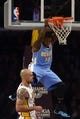 Jan 5, 2014; Los Angeles, CA, USA; Denver Nuggets guard Nate Robinson (10) dunks the ball against the Los Angeles Lakers during the fourth period at Staples Center. The Denver Nuggets defeated the Los Angeles Lakers 137-115. Mandatory Credit: Kelvin Kuo-USA TODAY Sports