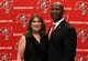 Jan 6, 2014; Tampa, FL, USA; Tampa Bay Buccaneers head coach Lovie Smith is introduced as head coach and poses with wife  MaryAnne Smith during a press conference at One Buccaneer Place. Mandatory Credit: Kim Klement-USA TODAY Sports