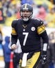 Dec 29, 2013; Pittsburgh, PA, USA; Pittsburgh Steelers quarterback Ben Roethlisberger (7) reacts at the line of scrimmage against the Cleveland Browns during the third quarter at Heinz Field. The Steelers won 20-7. Mandatory Credit: Charles LeClaire-USA TODAY Sports