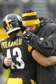 Dec 29, 2013; Pittsburgh, PA, USA; Pittsburgh Steelers strong safety Troy Polamalu (43) embraces quarterback Ben Roethlisberger (right) during warm ups before playing the Cleveland Browns at Heinz Field. The Steelers won 20-7. Mandatory Credit: Charles LeClaire-USA TODAY Sports