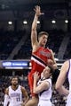 Jan 7, 2014; Sacramento, CA, USA; Sacramento Kings point guard Jimmer Fredette (7) is called for a foul against Portland Trail Blazers center Meyers Leonard (11) during the second quarter at Sleep Train Arena. Mandatory Credit: Kelley L Cox-USA TODAY Sports
