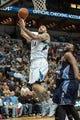 Jan 10, 2014; Minneapolis, MN, USA; Minnesota Timberwolves center Nikola Pekovic (14) shoots in the third quarter against the Charlotte Bobcats at Target Center. Minnesota wins 119-92. Mandatory Credit: Brad Rempel-USA TODAY Sports