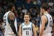 Jan 10, 2014; Minneapolis, MN, USA; Minnesota Timberwolves center Ronny Turiaf (32) and point guard J.J. Barea (11) and power forward Kevin Love (42) talk during an official review in the fourth quarter against the Charlotte Bobcats at Target Center. Minnesota wins 119-92. Mandatory Credit: Brad Rempel-USA TODAY Sports