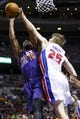 Jan 11, 2014; Auburn Hills, MI, USA; Phoenix Suns power forward Marcus Morris (15) shoots defended by Detroit Pistons small forward Kyle Singler (25) in the first half at The Palace of Auburn Hills. Mandatory Credit: Rick Osentoski-USA TODAY Sports