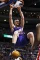 Jan 11, 2014; Auburn Hills, MI, USA; Phoenix Suns center Miles Plumlee (22) dunks in the first half against the Detroit Pistons at The Palace of Auburn Hills. Mandatory Credit: Rick Osentoski-USA TODAY Sports