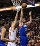 Jan 11, 2014; Philadelphia, PA, USA; Philadelphia 76ers center Spencer Hawes (00) takes a shot as New York Knicks power forward Andrea Bargnani (77) defends during the game at the Wells Fargo Center. The New York Knicks won 102-92.Mandatory Credit: John Geliebter-USA TODAY Sports