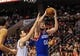 Jan 11, 2014; Philadelphia, PA, USA; Philadelphia 76ers center Spencer Hawes (00) drives to the net as New York Knicks power forward Andrea Bargnani (77) defends during the game at the Wells Fargo Center. The New York Knicks won 102-92.Mandatory Credit: John Geliebter-USA TODAY Sports