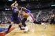Jan 11, 2014; Auburn Hills, MI, USA; Detroit Pistons center Andre Drummond (0) moves the ball on Phoenix Suns center Alex Len (21) in the third quarter at The Palace of Auburn Hills. Detroit won 110-108. Mandatory Credit: Rick Osentoski-USA TODAY Sports