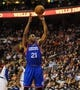 Jan 11, 2014; Philadelphia, PA, USA; Philadelphia 76ers power forward Thaddeus Young (21) takes a foul shot during the game against the New York Knicks at the Wells Fargo Center. The New York Knicks won 102-92.Mandatory Credit: John Geliebter-USA TODAY Sports